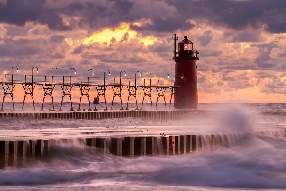 The beacon of the South Haven lighthouse shines bright as it watches another day turn to night on the shore of Lake Michigan