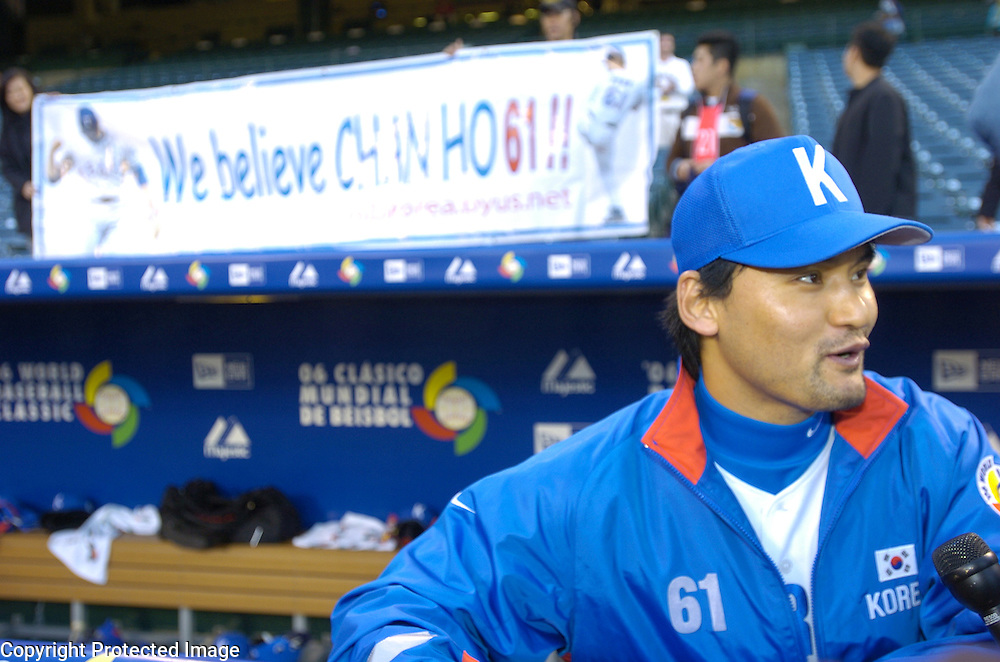 Team Korea's Chan Ho Park speaks to reporters before the start of Round 2 action against Team USA at Angel Stadium of Anaheim.