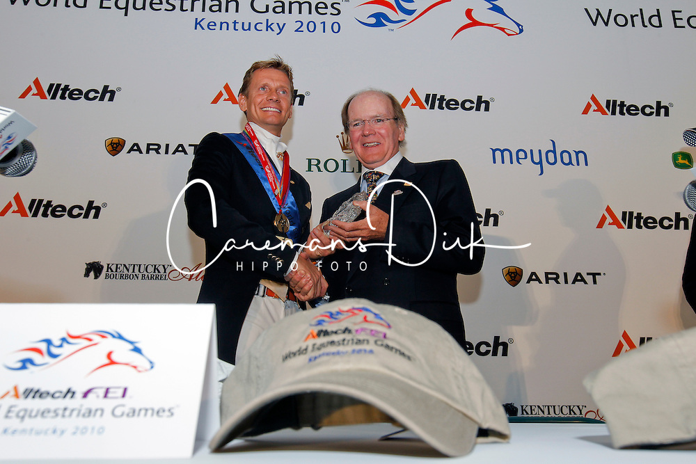 Dr. Pierce Lyons, President Alltech presenting the trophy to Edward Gal (NED) wining his third gold medal in one week<br /> Alltech FEI World Equestrian Games <br /> Lexington - Kentucky 2010<br /> © Dirk Caremans
