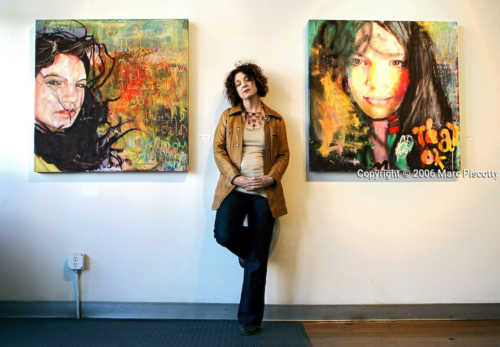 Denver artist Julie Puma (cq), 40, photographed next to some of her work that opens with a show entitled 'The Pink and Green Afterlife' at Space Gallery on Santa Fe Drive. Puma's mother and sister both died of breast cancer and Puma herself has undergone a double prophalactic mastectomy, a preventative surgery to avoid breast cancer, herself. The mixed media artwork in the show features her 14 year-old niece, Olivia Lewis..(MARC PISCOTTY/ © 2006)
