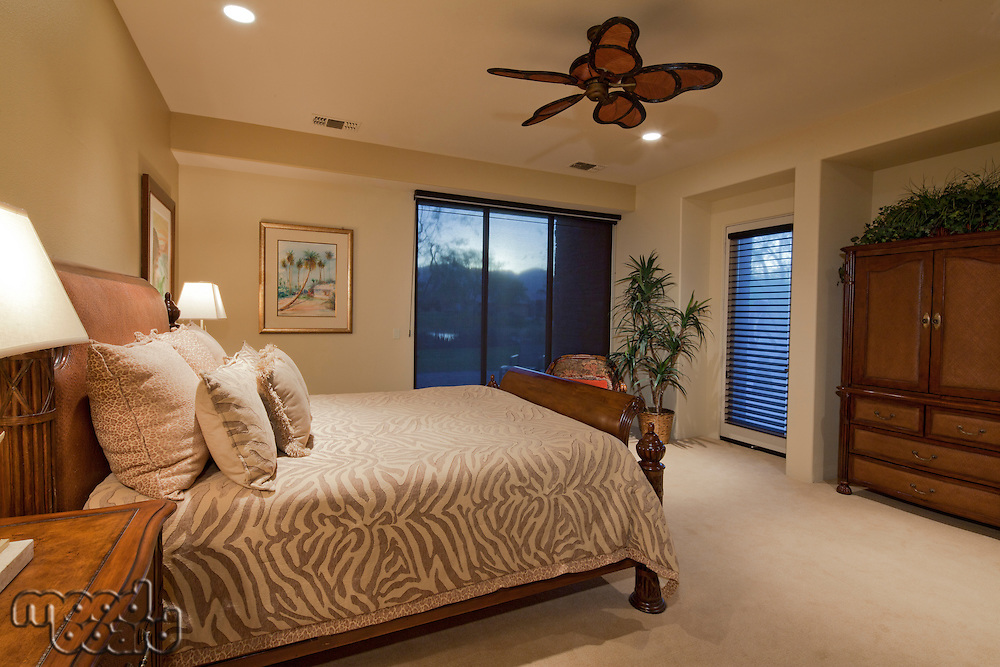 Bedroom with ceiling fan in manor house