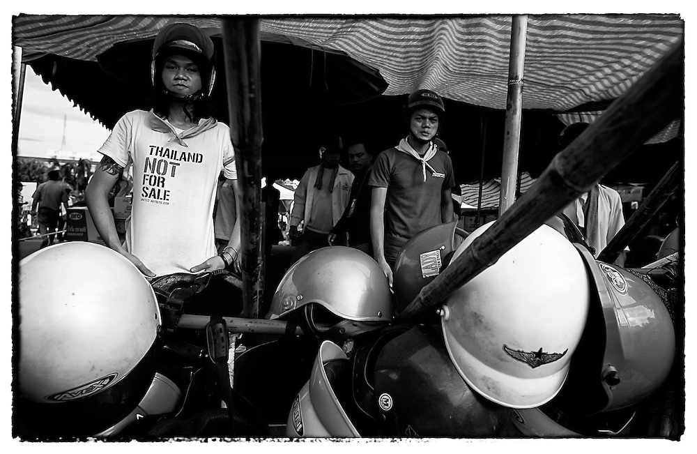 Anti-government demonstrators stand watch at a makeshift barricade Tuesday, Sept. 1, 2008, near Government House in Bangkok, Thailand.  (David Longstreath)