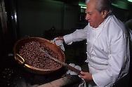 France. Lyon. Mr Bernachon senior in his kitchen  / / Bernachon père dans son laboratoire./ / Bernachon, c'est l'empereur du chocolat. Il a ete le premier en France à choisir ses fèves de cacao et à les torrefier lui même. Sa boutique du cours Franklin est un veritable palais du goût. / / R00069/11    L931015a  /  P0000237