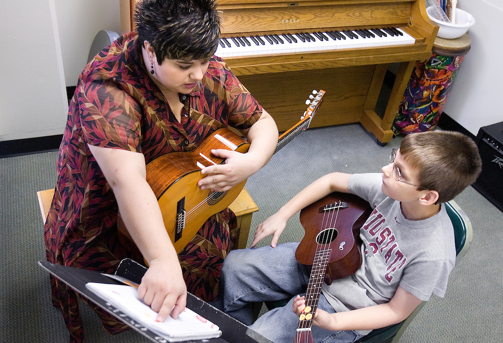 O.U. graduate student Renata Geyer works with T.J. Jarrell, nine, during a music therapy session on campus on Saturday, 10/28/06.
