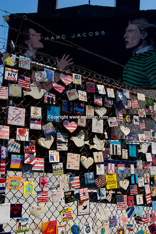 New York The parking lot's fencing supports Tiles for America, a September 11 memorial consisting of some 6,000 tiles created across the country. There's a proposal to turn Mulry Square into a small park.