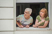 residents watch expectantly - Crowds flock to see the 50th Notting hill carnival on Bank Holiday Monday.