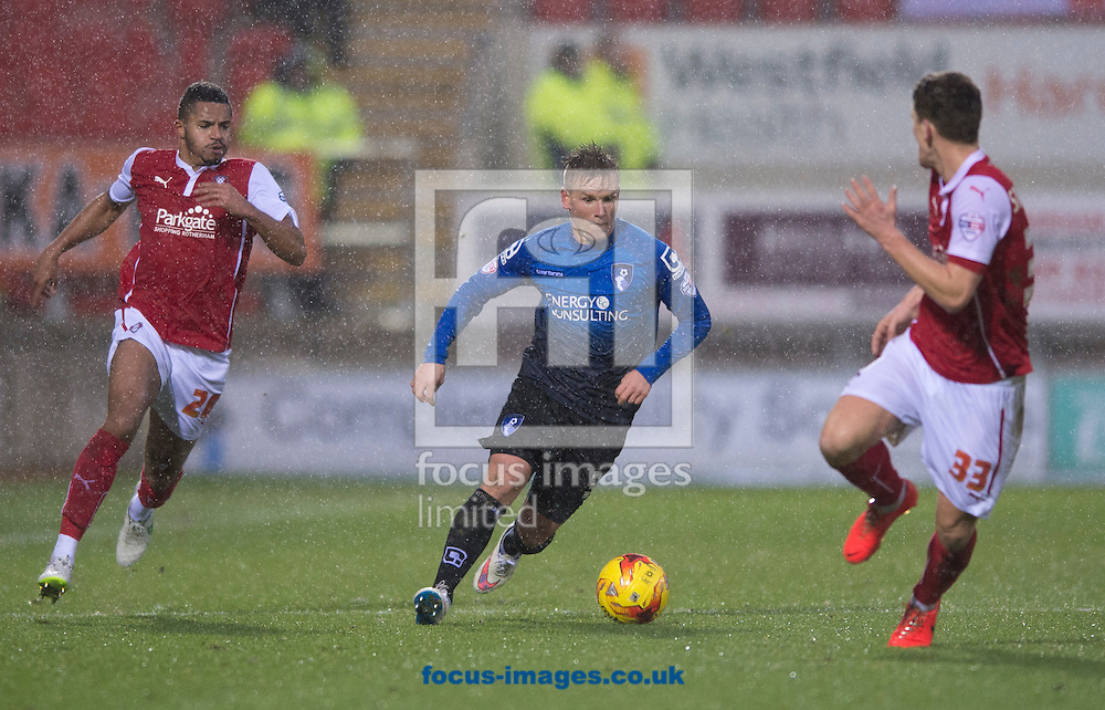 Matt Ritchie of Bournemouth (centre) with Zeki Fryers of Rotherham United (left) and Richard Smallwood of Rotherham United (right) during the Sky Bet Championship match at the New York Stadium, Rotherham<br /> Picture by Russell Hart/Focus Images Ltd 07791 688 420<br /> 17/01/2015
