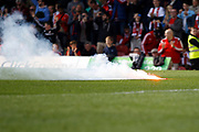 Brentford fans throw a second flare on to the pitch to celebrate their second (2-0) during the EFL Sky Bet Championship match between Brentford and Queens Park Rangers at Griffin Park, London, England on 22 April 2017. Photo by Andy Walter.