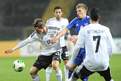 15.10.2013, Auestadion, Kassel, GER, UEFA U21 EM Qualifikation, Deutschland vs Faroer Inseln, Gruppe 6, 8. Runde, im Bild Kampf um den Ball zwischen Erik Durm (Deutschl, U21, Borussia Dortm, ) (L), Ari O Ellingsgaard (Faroer Isl, s U21), Aktion, Action // during the UEFA U21 European Championship group six 8th round qualifier between Germany and Faroe Islands at the Auestadion in Kassel, Germany on 2013/10/15. EXPA Pictures © 2013, PhotoCredit: EXPA/ Eibner-Pressefoto/ Sippel<br /> <br /> *****ATTENTION - OUT of GER*****
