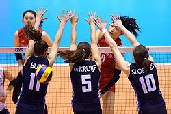 15-05-2016 JAP: OKT Nederland - Zuid Korea, Tokio<br /> Er is nog niets verloren, maar de volleybalsters van Oranje hebben tijdens het OKT een gevoelige 3-0 nederlaag geleden tegen Zuid-Korea / Sterspeelster Yeon-Koung KimC #10 of Korea slaat door het blok van Anne Buijs #11, Robin de Kruijf #5, Lonneke Sloetjes #10
