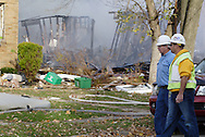 Utility crews in the area of a house in the 300 block of Wayne Drive destroyed by what appears to be a gas-line explosion in Fairborn, Saturday, November 12, 2011.