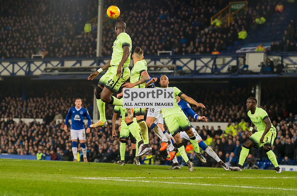 Manchester City midfielder Yaya Toure gets in a clearing header in the Football League cup semi-final first leg at Goodison Park, Liverpool