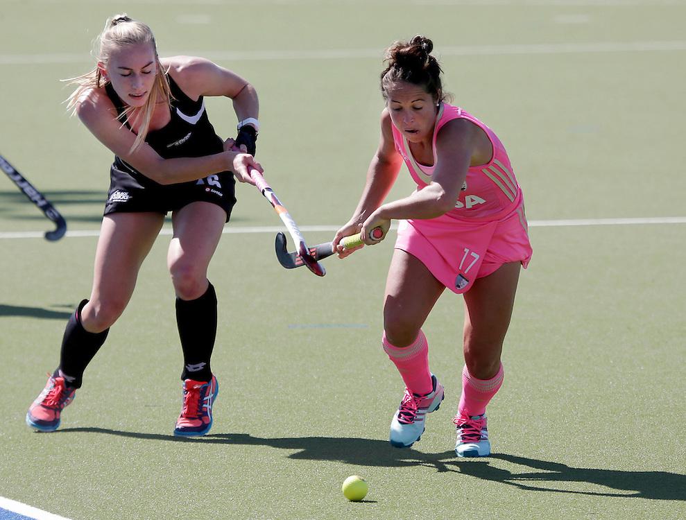 Argentina's Rocio Sanchez Moccia, right, chases New Zealand Black Stick Liz Thompson in a International hockey test, Blenheim, New Zealand, Saturday, October 03,  2015.  Credit:SNPA / Anthony Phelps