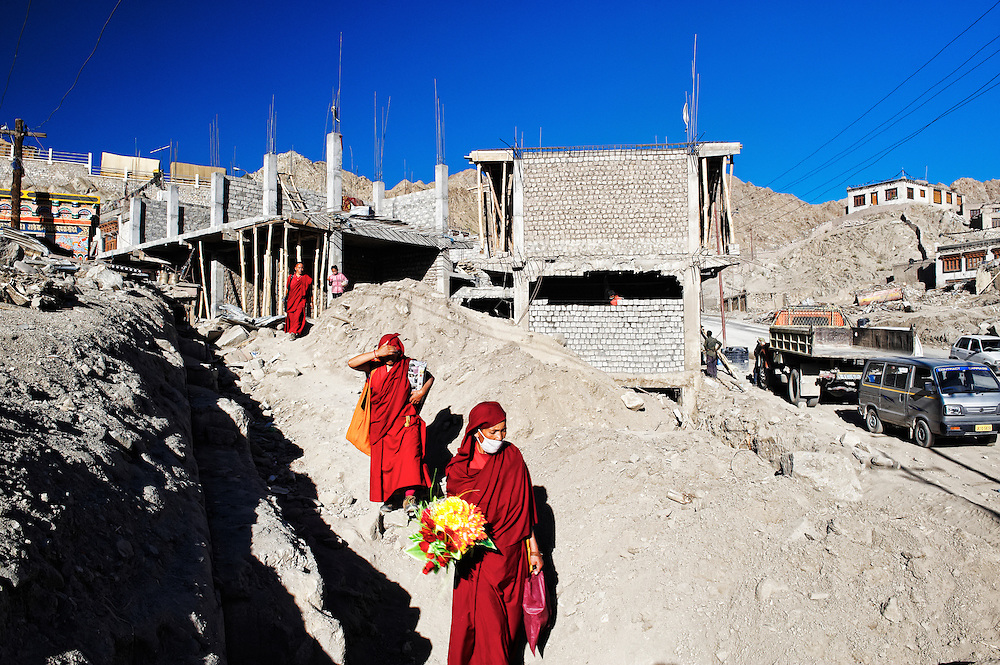 Nuns making their way out of debris in Leh. The city was badly hit by flash floods following a cloudburst on 6th Aug. 2010.