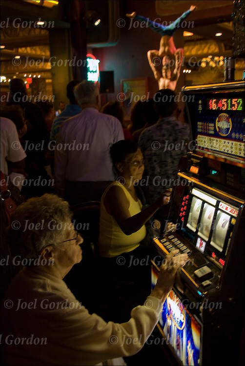 People gambling with the expectation of winning playing slot machines in Altantic City Casino