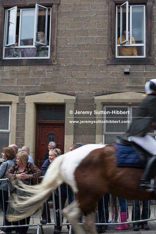 The (approx 360) horsemen gallop up Scott Street, during the Gala Braw Lads Gathering, with Braw Lad Daniel Whitehead, in Galashiels, Scotland, Saturday 29th June 2013.<br /> N55&deg;36.943'<br /> W2&deg;48.742'
