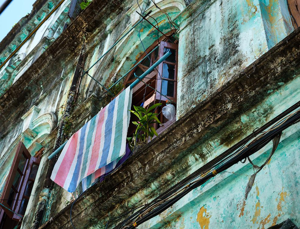 YANGON, MYANMAR - CIRCA DECEMBER 2017: Typical windown in the streets of Yangon