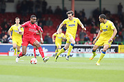 Swindon Town striker Jonathan Obika (9) and AFC Wimbledon defender Sean Kelly (22) in chase during the EFL Sky Bet League 1 match between Swindon Town and AFC Wimbledon at the County Ground, Swindon, England on 14 April 2017. Photo by Stuart Butcher.