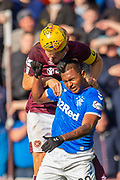 Christophe Berra (#6) of Heart of Midlothian FC wins a header against Alfredo Morelos (#20) of Rangers FC during the Ladbrokes Scottish Premiership match between Heart of Midlothian and Rangers FC at Tynecastle Park, Edinburgh, Scotland on 20 October 2019.