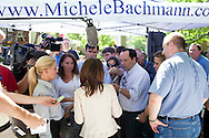 Republican presidential hopeful Rep. Michele Bachmann (R-MN) talks with reporters after a campaign stop on Wednesday, July 20, 2011 in Norwalk, IA.