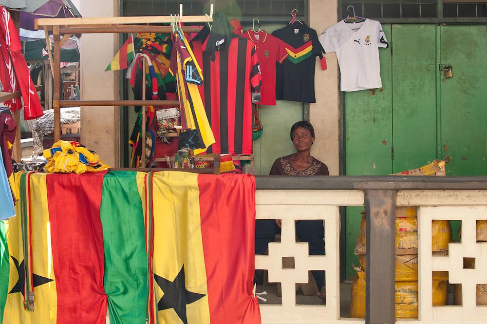 Woman sells flags at Makola Market, Accra, Ghana 2011