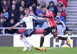 Sunderland's Ricardo Alvarez competes with West Bromwich Albion's Chris Brunt - Photo mandatory by-line: Richard Martin-Roberts/JMP - Mobile: 07966 386802 - 21/02/2015 - SPORT - Football - Sunderland - Stadium of Light - Sunderland v West Bromwich Albion - Barclays Premier League