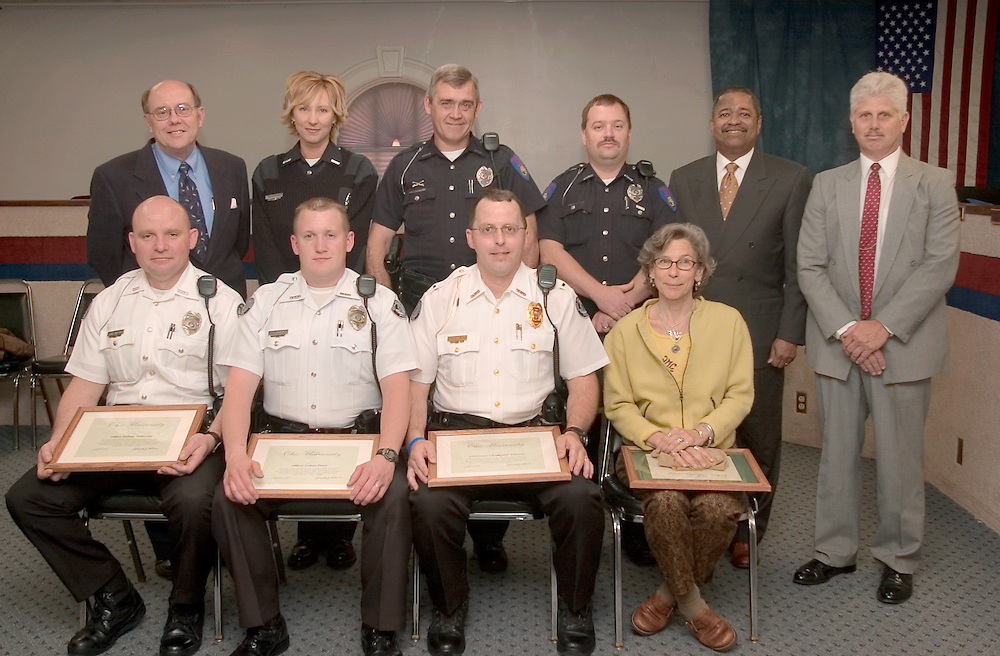 Library Commendations..Front row: (from left) Ohio University Police Department officers George Anderson, Joshua Durst and Christopher Johnson and Alden Library staff member Lorraine Wochna; Back row: (from left) Athens Mayor Ric Abel, Athens Police Department Communications Officer Amber Guthrie, APD officers Neil Dicken and Ron Brooks, Ohio University President Roderick J. McDavis and OUPD Chief Tony Camechis...-30-