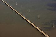 Highway bridge and power lines across Apalachicola Bay, FL.