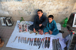 August 26, 2017 - Rawalpindi, Punjab, Pakistan - Afghan refugee kids sale ornaments for sacrificial animals on a roadside  ahead of the Eid al-Adha festival. (Credit Image: © Zubair Abbasi/Pacific Press via ZUMA Wire)