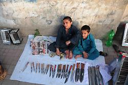 August 26, 2017 - Rawalpindi, Punjab, Pakistan - Afghan refugee kids sale ornaments for sacrificial animals on a roadside  ahead of the Eid al-Adha festival. (Credit Image: © Zubair Abbasi/Pacific Press via ZUMA Wire)