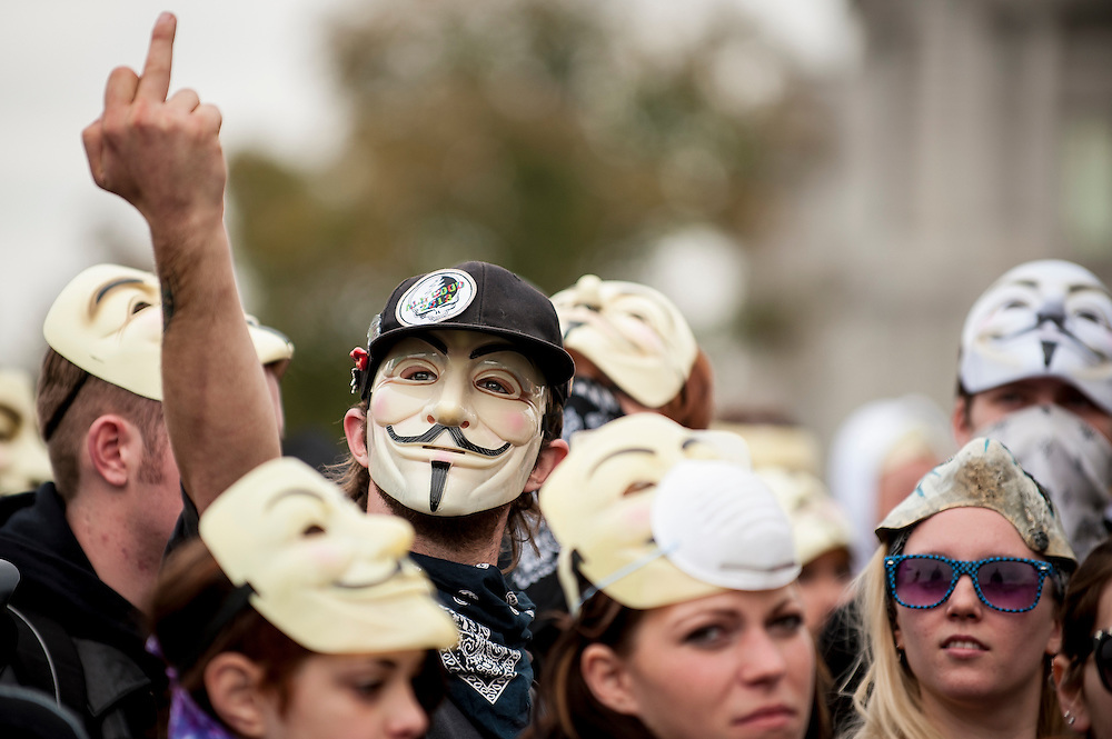 Demonstrators and supporters of the group Anonymous march in front of the U.S. Capitol in Washington, D.C. in protest against corrupt governments and corporations as part of a Million Mask March of similar rallies around the world on Guy Fawkes Day.