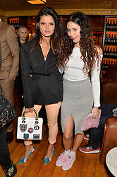 Left to right, BIP LING and ELIZA DOOLITTLE at the Kiehl's Icons VIP Dinner held at the Balthazar Dining Room, Wellington Street, London on 26th March 2014.