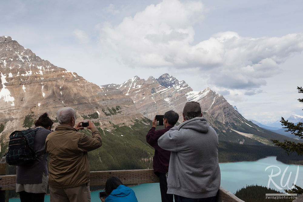 Crowd of Tourists Shooting Photos of Peyto Lake from Bow Summit, Banff National Park, Alberta, Canada