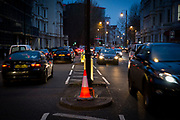 Glowing traffic cones on busy west London road at night in London, United Kingdom. (photo by Andrew Aitchison / In pictures via Getty Images)