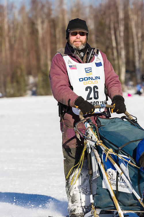 Musher Robert Bundtzen competing in the 44th Iditarod Trail Sled Dog Race on Long Lake after leaving the restart on Willow Lake in Southcentral Alaska.  Afternoon. Winter.