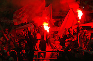 Polish football fans light flares during a Wales v Poland football international at the Millennium Stadium in Cardiff.