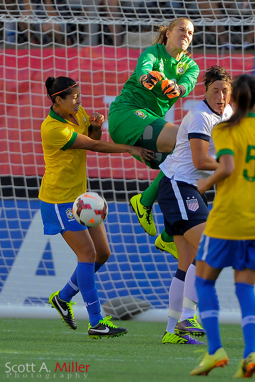 Brazil goalkeeper Luciana (12) goes airborne over U.S. forward Abby Wambach (20) for a save on the ball during an international friendly at the Florida Citrus Bowl on Nov. 10, 2013 in Orlando, Florida. The U.S. won 4-1.<br /> <br /> <br /> &copy;2013 Scott A. Miller
