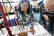 Artist Marie Tate, left, shows shopper Jim Von De Lindee her turquoise jewelry during the Winter Market at the Utah Cultural Celebration Center, Saturday, Dec. 1, 2012.