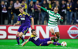 Aleksander Rajcevic of Maribor vs João Mário of Sporting during football match between NK Maribor and Sporting Lisbon (POR) in Group G of Group Stage of UEFA Champions League 2014/15, on September 17, 2014 in Stadium Ljudski vrt, Maribor, Slovenia. Photo by Vid Ponikvar  / Sportida.com
