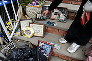 Nov. 2, 2012. Marie Demarco, a resident of the South Beach neighborhood on Staten Island, New York, displays some of the few photos and mementos that were salvaged from her garage after Hurricane Sandy left the ground floor of her house under six feet of water earlier in the week.