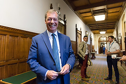© Licensed to London News Pictures. 12/07/2018. London, UK.  Nigel Farage, former UKIP leader leaves after speaking in support of Donald Trump's visit to London at a Bow Group event held in the Palace of Westminster. A bust of Donald Trump was seen sat on the table in front of Nigel Farage. Photo credit: Vickie Flores/LNP