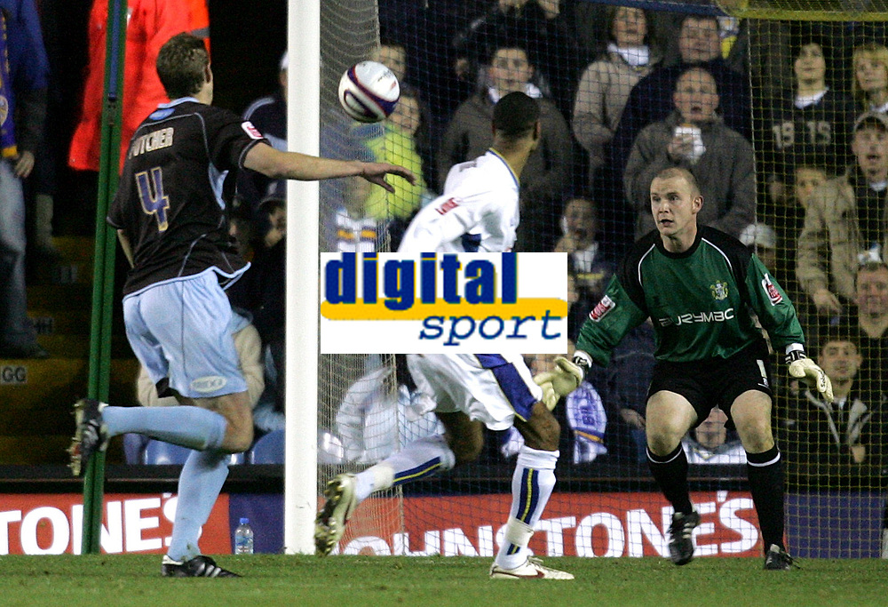 Photo: Paul Thomas/Sportsbeat Images.<br />Leeds United v Bury FC. Johnstone's Paint Trophy. 13/11/2007.<br /><br />Leon Constantine (White) of Leeds chips the ball past Bury keeper Robert Provett (R) to score.