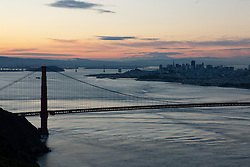 """Golden Gate Bridge Sunrise 2"" - Photograph of San Francisco's famous Golden Gate Bridge at sunrise. San Francisco can be seen in the distance."