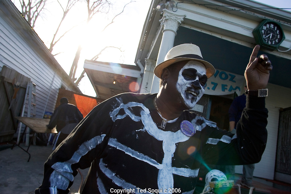 A member of the North Side Skull and Bones skeleton gang, the original Skeleton Gang. They remind people that living is comprised both of life and death as they roam neighborhoods singing and performing skits on the streets during Mardis Gras..Mardis Gras six months after hurricane Katrina damaged much of New Orleans. The city is still empty in the lower 9th and ward and St. Bernards Parish, but many of the cities residents came back to participate and celebrate..