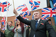 "Bromley, Greater London, UK. 4th November 2017. Pictured:  Paul Golding and Jayda Fransen stand outside Bromley Police Station. / Up to 60 Britain First supporters hold a ""Persecuted Patriots Rally"" in Bromley, south London, in defence of their leaders Paul Golding and Jayda Fransen. According to the far-right group's Facebook page ""The authorities are hell bent on sending Britain First leaders Paul Golding and Jayda Fransen to prison! The police have forced them to sign on at Bromley Police Station (south east London) every Saturday at 2pm. Join us in Bromley on 4th November to march in defiance of the police bullies!"" Scores of police formed a barrier between the Britain First supporters and a vocal anti-fascist group of up to 150 people consisting of Unite Against Fascism, trades unions, and the muslim community.  // Lee Thomas, Tel. 07784142973. Email: leepthomas@gmail.com  www.leept.co.uk (0000635435)"