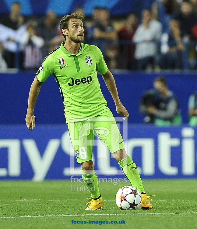 Claudio Marchisio of Juventus during the UEFA Champions League match at Vicente Calder&oacute;n Stadium, Madrid<br /> Picture by Stefano Gnech/Focus Images Ltd +39 333 1641678<br /> 01/10/2014