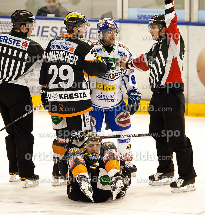 30.12.2011, Eisstadion Liebenau, Graz, AUT, EBEL, Moser Medical Graz 99ers vs EC Rekord Fenster VSV im Bild Roland Kaspitz (EC Rekord Fenster VSV, #8, Forward) und Sven Klimbacher (Moser Medical Graz 99ers, #29, Defender) mit dem verletzten Patrick Harand (Moser Medical Graz 99ers, #16, Offender) am Boden // during the Erste Bank Icehockey League, Eisstadion Liebenau, Graz, Austria, 2011-12-30, EXPA Pictures © 2011, PhotoCredit: EXPA/ E. Scheriau