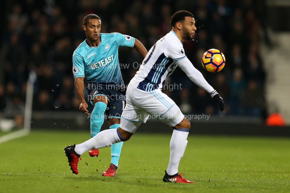 Wayne Routledge of Swansea city (l) in action. Premier league match, West Bromwich Albion v Swansea city at the Hawthorns stadium in West Bromwich, Midlands on Wednesday 14th December 2016. pic by Andrew Orchard, Andrew Orchard sports photography.