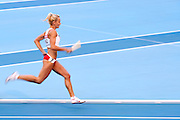 Justyna Swiety from Poland competes in women's relay 4x400 meters qualification during the 14th IAAF World Athletics Championships at the Luzhniki stadium in Moscow on August 16, 2013.<br /> <br /> Russian Federation, Moscow, August 16, 2013<br /> <br /> Picture also available in RAW (NEF) or TIFF format on special request.<br /> <br /> For editorial use only. Any commercial or promotional use requires permission.<br /> <br /> Mandatory credit:<br /> Photo by &copy; Adam Nurkiewicz / Mediasport