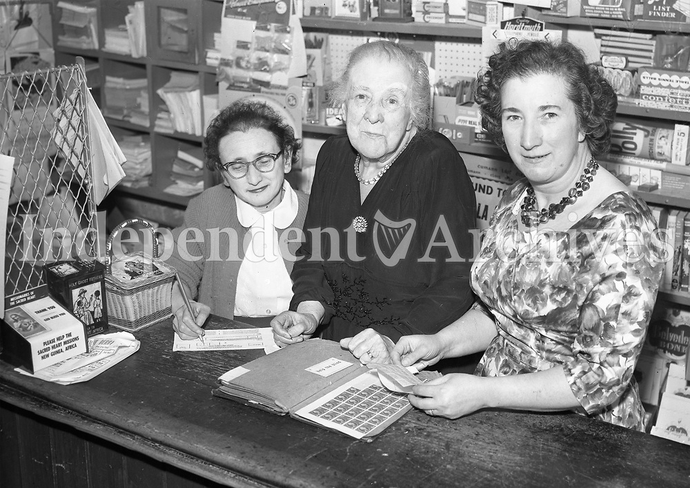Mrs. W. Rilty retiring postmistress in Clondalkin with her daughters Josephine left and Mrs. Dympna O'Brien. May 29 1964. (Part of the Independent Ireland Newspapers/NLI Collection)